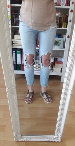 Ripped Jeans Hose Löcher Cut outs