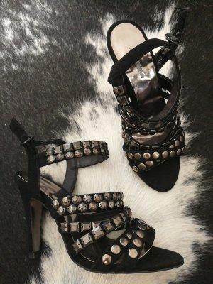 Rockige schwarze Sandaletten