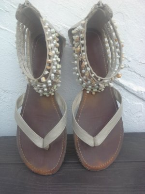 Sandalias romanas beige claro