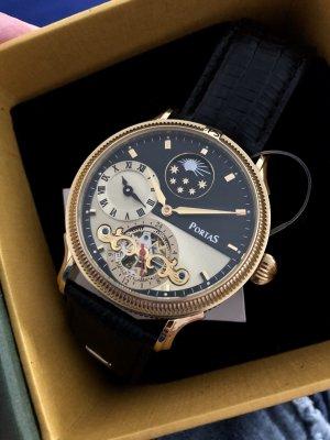 Romantisch-verspielte Armbanduhr