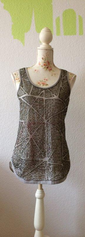 Romeo & Juliet Couture - Pailetten-Oberteil in silber-grau mit silbernen Pailettenstickerei auf dem Vorderteil