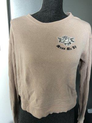 Rosa farbener Pullover mit Aufdruck