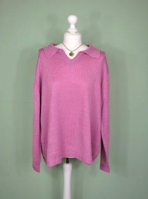 Rosa Farbener Pullover mit Schlitzen an den Seiten