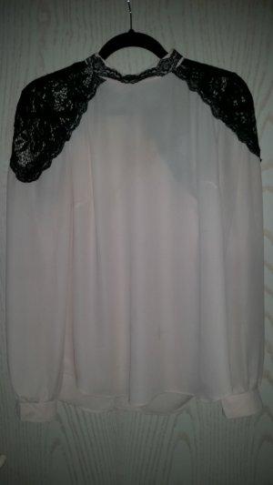 rosa Langarm-Bluse mit schwarzer Spitze