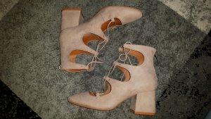 Rosa Schuhe von H&M.