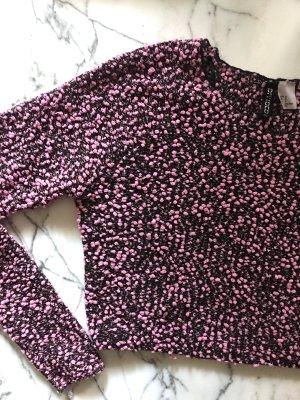 Rosa-schwarzer Crop Pullover