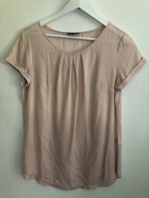 Rosa Shirt aus fließendem Stoff
