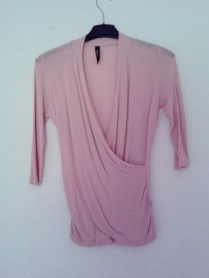 Rosa Shirt im Wickeloptik