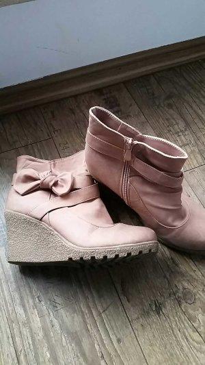 rosa Stiefeletten mit Zierschleife