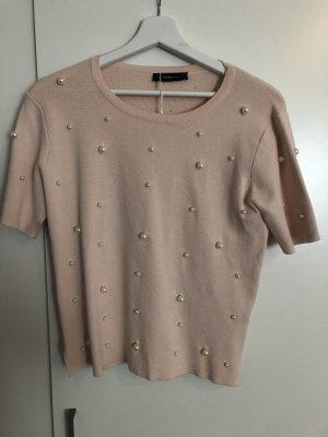 Rosa T-Shirt mit Perlen