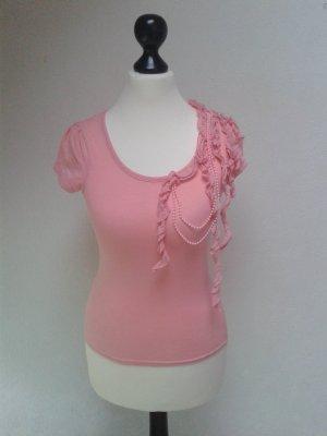 Rosa T-Shirt mit Rüschenbändern