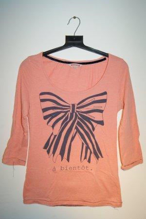 rosafarbenes Shirt mit großer Schleife