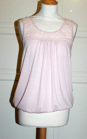 rosafarbenes Shirt mit Gummibund und Spitzenbesatz