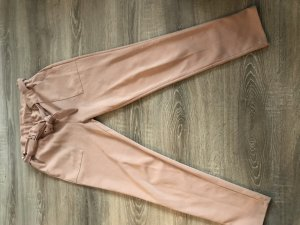 Pantalón elástico color rosa dorado