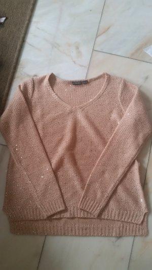 Rosefarbener Pullover mit Glitzerpailetten