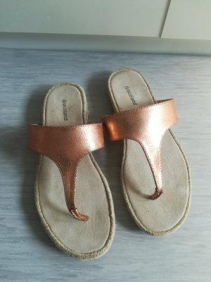 roségoldene Flip-flops/Zehentrenner