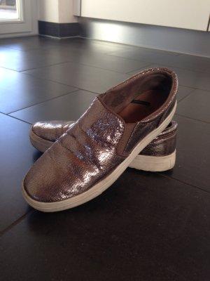 Roségoldene Sneakers