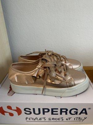 rosegoldener Sneaker