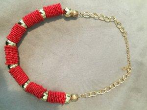 rot goldene Perlenkette