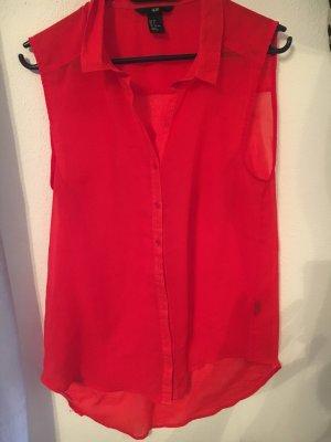 Rote ärmellose Bluse