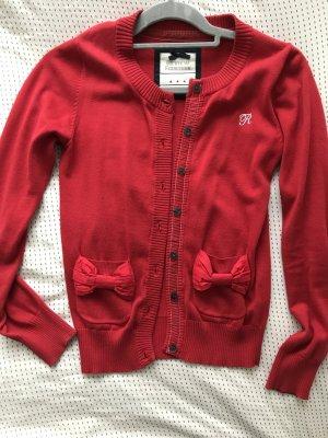Rote elegante Strickjacke