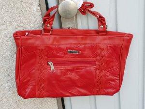 rote kunstledertasche