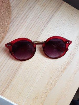 Rote runde Sonnebrille von Urban Outfitters
