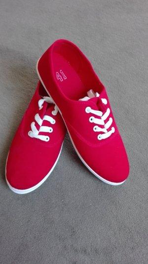 Rote Sneakers mit weißem Boden
