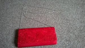 Clutch red-silver-colored