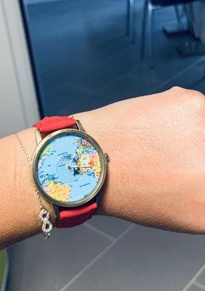 Rote Weltuhr Armbanduhr mit Flugzeug als Sekundenzeiger