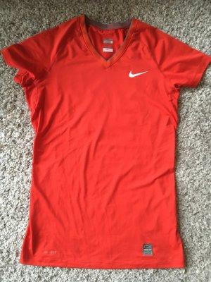 Rotes Sportshirt von Nike mit V-Ausschnitt