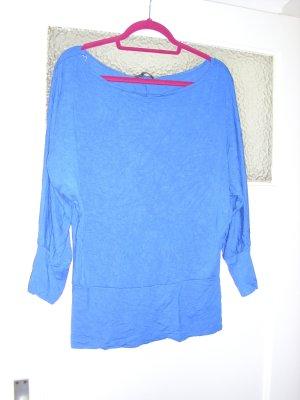 Camisa de un solo hombro azul