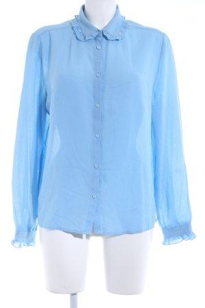 Blusa con volantes azul aciano elegante