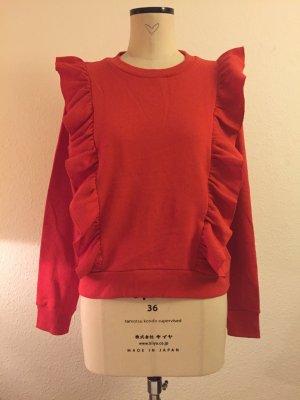 Rüschen Pullover in der Trendfarbe Orangerot