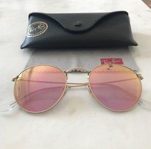Runde Ray Ban Sonnenbrile mit roségoldenen Gläsern