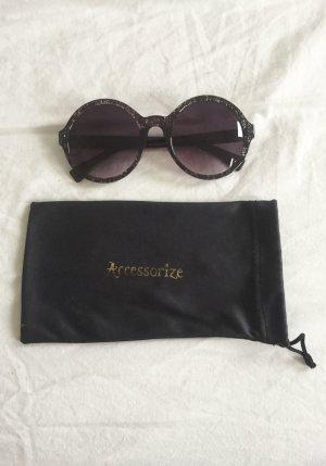 Runde Sonnenbrille mit gemustertem Rand und Verlauf inkl. kleiner Schutztasche