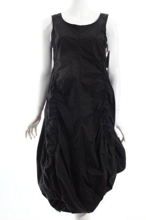 Rundholz Ballonkleid schwarz extravaganter Stil
