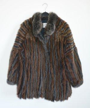Veste de fourrure gris-brun fourrure