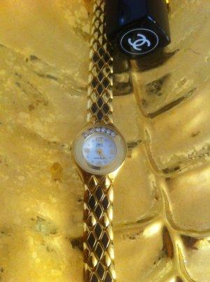 Reloj con pulsera metálica color oro-negro metal