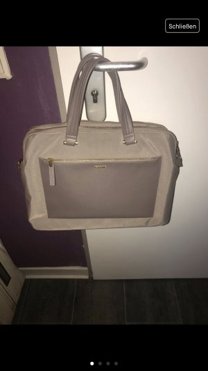 Samsonite bailhandle in beige