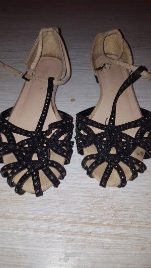 Sandalo con cinturino e tacco alto nero-bianco sporco