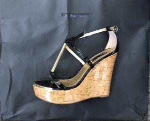 Sandalo alto con plateau nero-oro