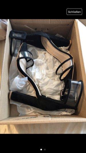 Sandalen mit Transparenten Riemen