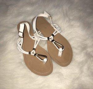 Sandalo toe-post bianco-oro
