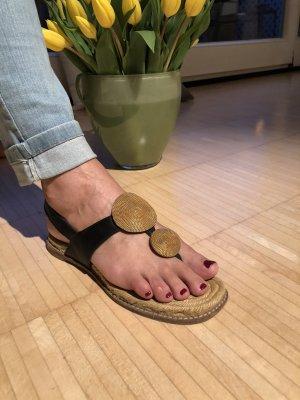 Sandalette mit goldenen Sonnenanähern