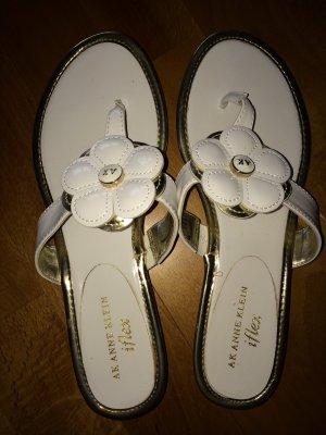 Sandalo infradito con tacco alto bianco-oro Finta pelle