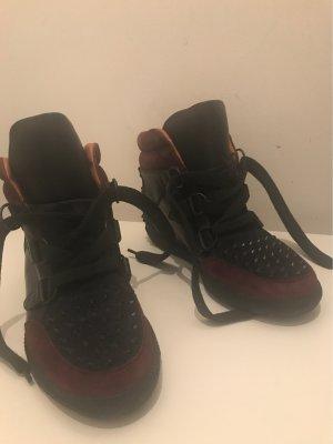 Sandro Sneakers mit Nieten