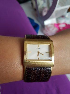 schicke goldene Spangen-Uhr
