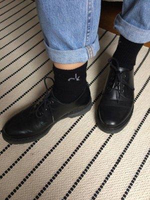 schicke schwarze Leder Schnürschuhe
