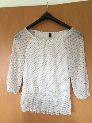 schicke weiße Bluse mit hellgrauen Punkten